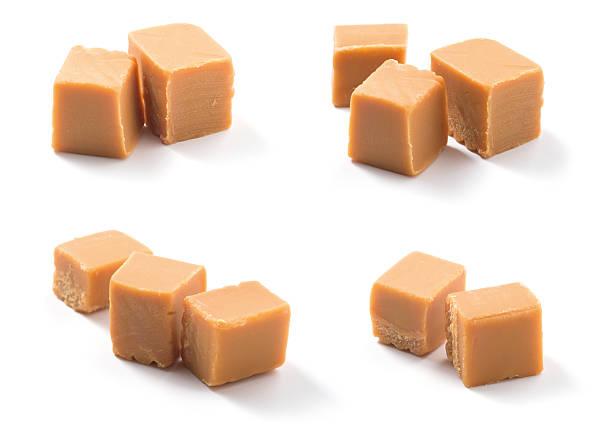 cubes of caramel candies over a white surface - fudge stockfoto's en -beelden