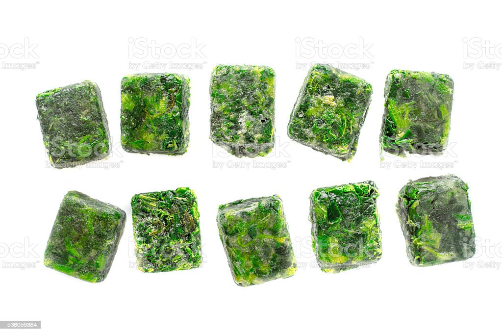 Cubes of frozen spinach on the white background – Foto
