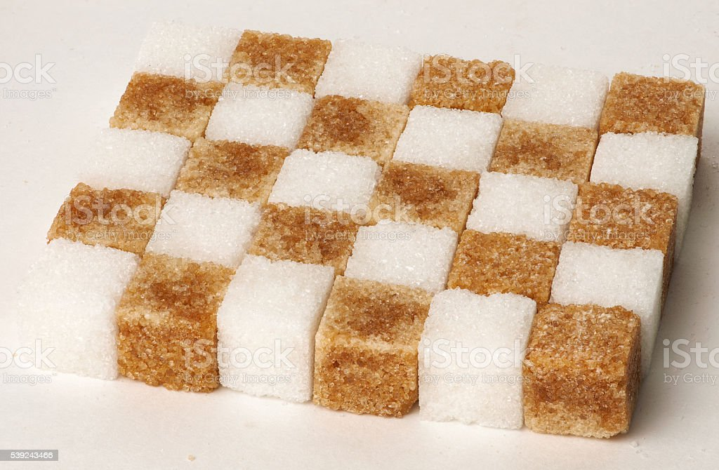 Cubes of sugar cane brown and white refined isolated royalty-free stock photo