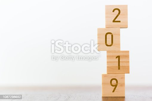 1066508880 istock photo 2019 cubes on wooden table with copy space for text 1087298652