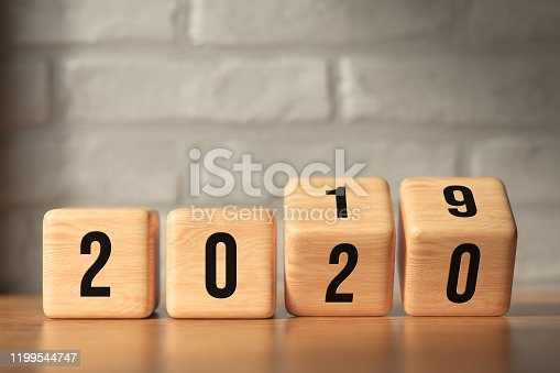 1186985932 istock photo cubes turning from year 2019 to 2020 - 3D rendered illustration 1199544747