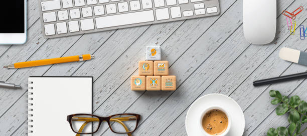 cubes with business icons at computer workplace stock photo