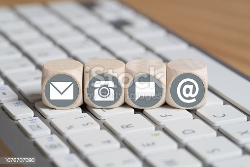 istock cubes with contact options on a computer keyboard 1076707090