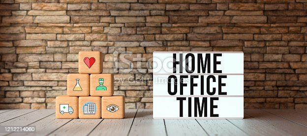 istock cubes with health-symbols stacked as a pyramid and lightbox with text HOME OFFICE TIME - 3D rendered illustration 1212214060