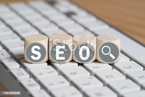 istock cubes with letters forming the acronym SEO on a keyboard 1090966888