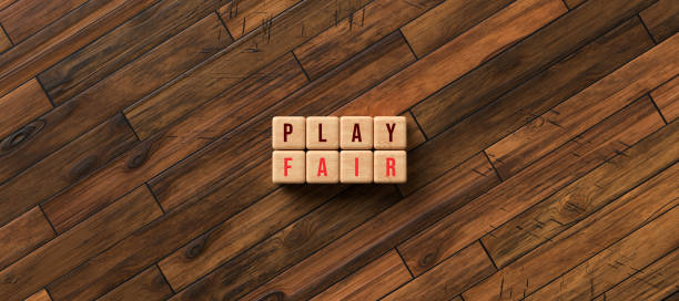 cubes with the message PLAY FAIR - 3D rendered illustration cubes with the message PLAY FAIR on wooden floor - 3D rendered illustration discriminatory stock pictures, royalty-free photos & images