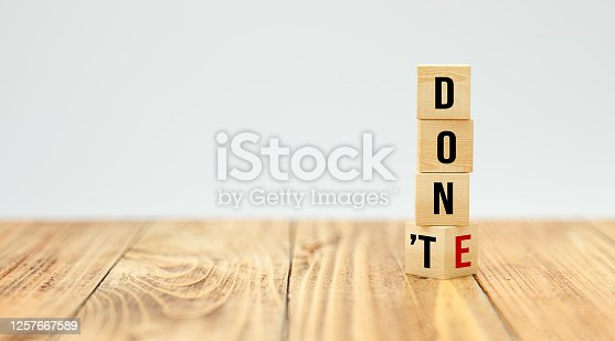 cubes with the words DON'T and DONE on white background - 3d illustration