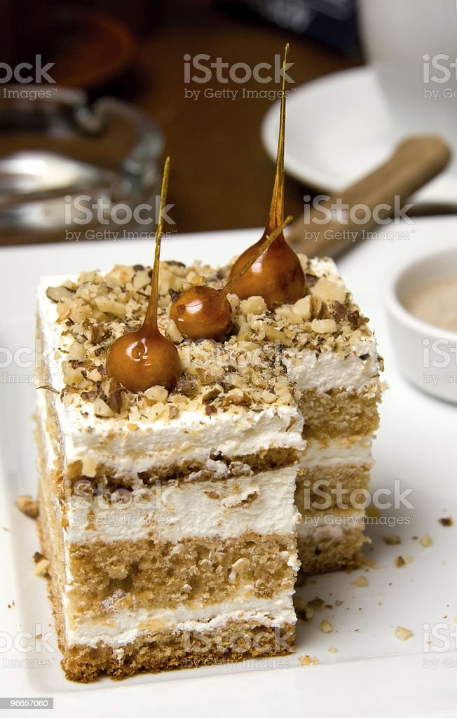 Cubic Sandwiched Cake with Caramel Decoration royalty-free stock photo