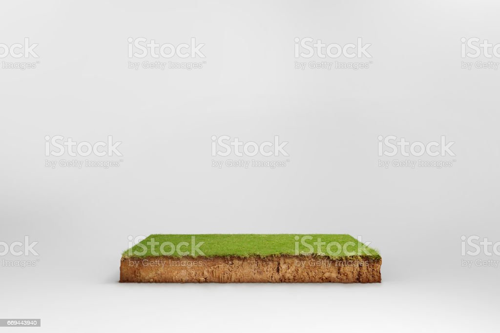 cubical cross section with underground earth soil and green grass on top stock photo