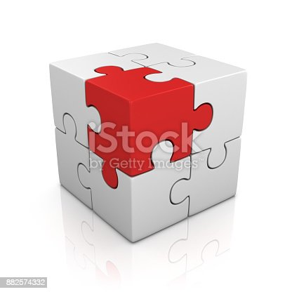 istock cubical puzzle with one red piece 882574332