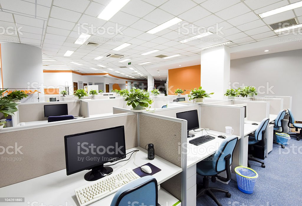 Cubicles and desks with computers in modern office stock photo