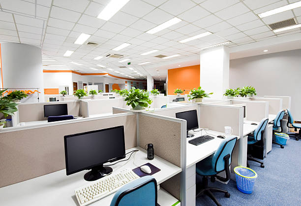 cubicles and desks with computers in modern office - office cubicle stock pictures, royalty-free photos & images