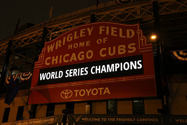 Cubs World Champions Chicago, IL, USA - November 3, 2016: The Wrigley Field sign on the night after the Cubs World Series Victory. The Cubs won the baseball World Series for the first time since 1908. major league baseball stock pictures, royalty-free photos & images