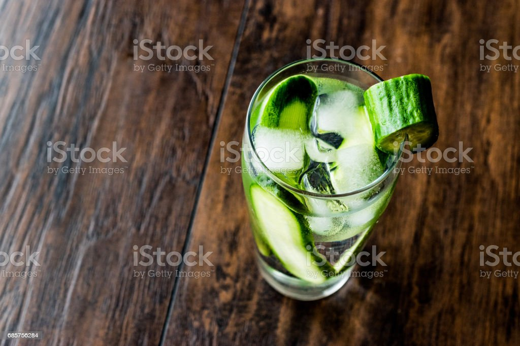 Cucumber Cocktail with vodka and tonic on dark wooden surface. zbiór zdjęć royalty-free