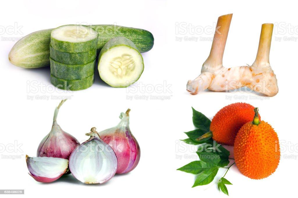 Cucumber, Ginger, shallot(onion), and gac fruit isolated on white stock photo