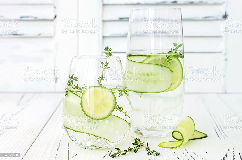 Cucumber infused hydrating water with thyme and lime stock photo