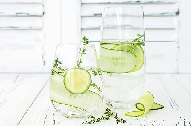 cucumber infused hydrating water with thyme and lime - cucumber stock photos and pictures