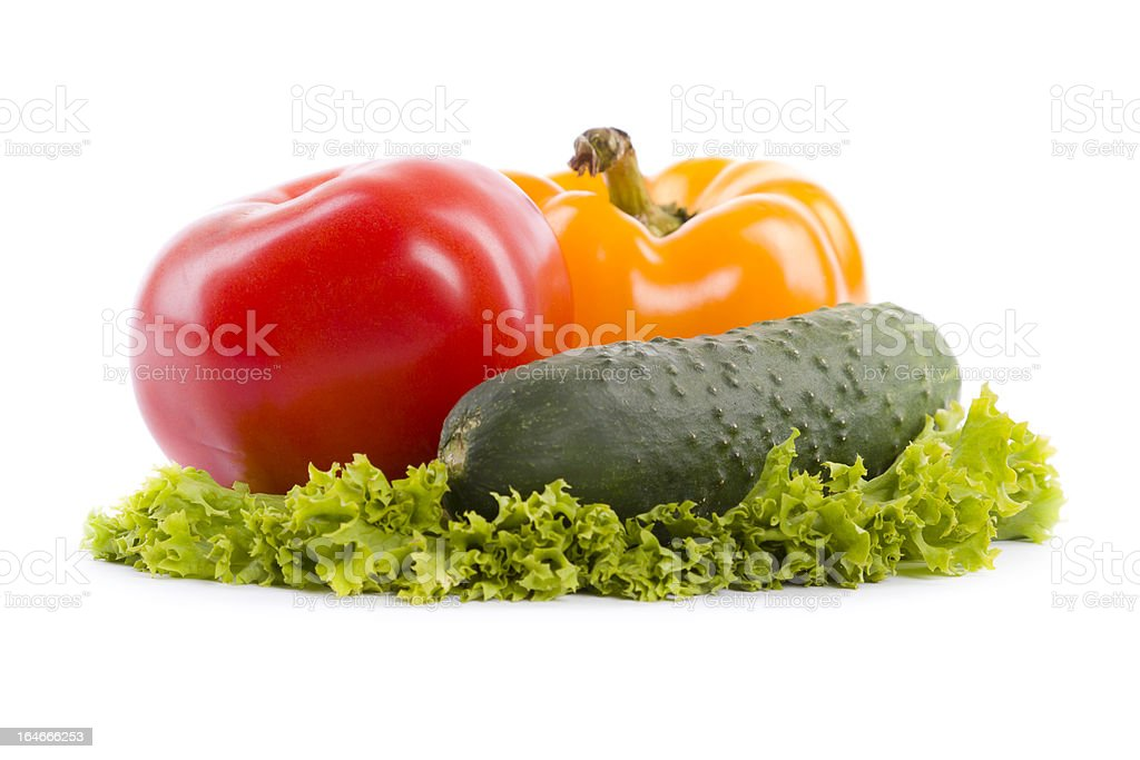 cucumber, pepper and tomato on lettuce royalty-free stock photo
