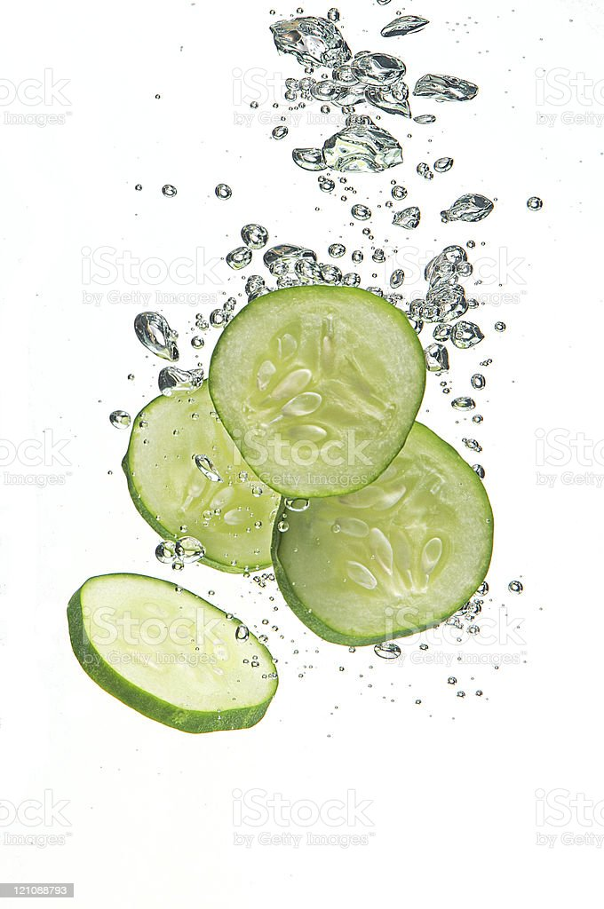 Cucumber segments in water stock photo