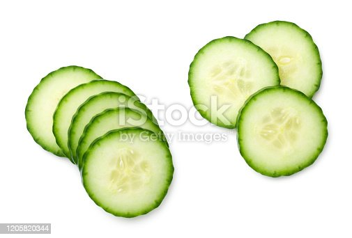 Cucumber slice isolated on white background. Light shadow. Top view, flat lay
