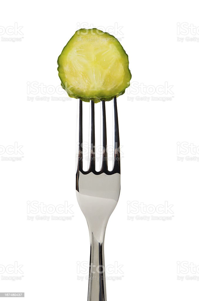Cucumber slice on fork royalty-free stock photo