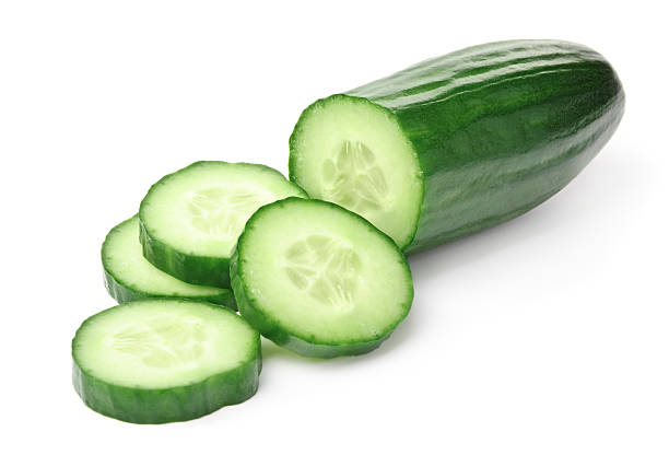 cucumber slices on a white background - cucumber stock photos and pictures