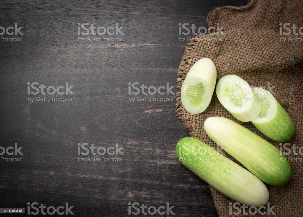 Cucumber slices on black wooden background,top view stock photo