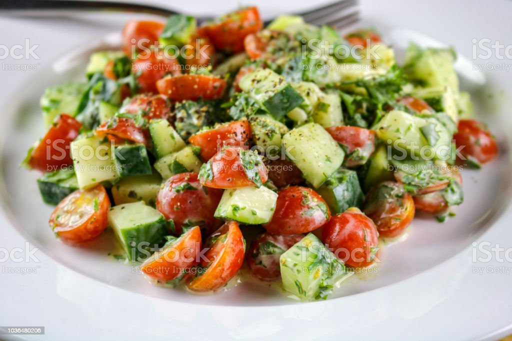 Cucumber, Tomato & Herb Salad with a Creamy Vinaigrette Dressing stock photo
