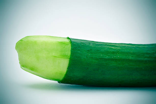 cucumber with the skin of its tip removed - circoncision photos et images de collection