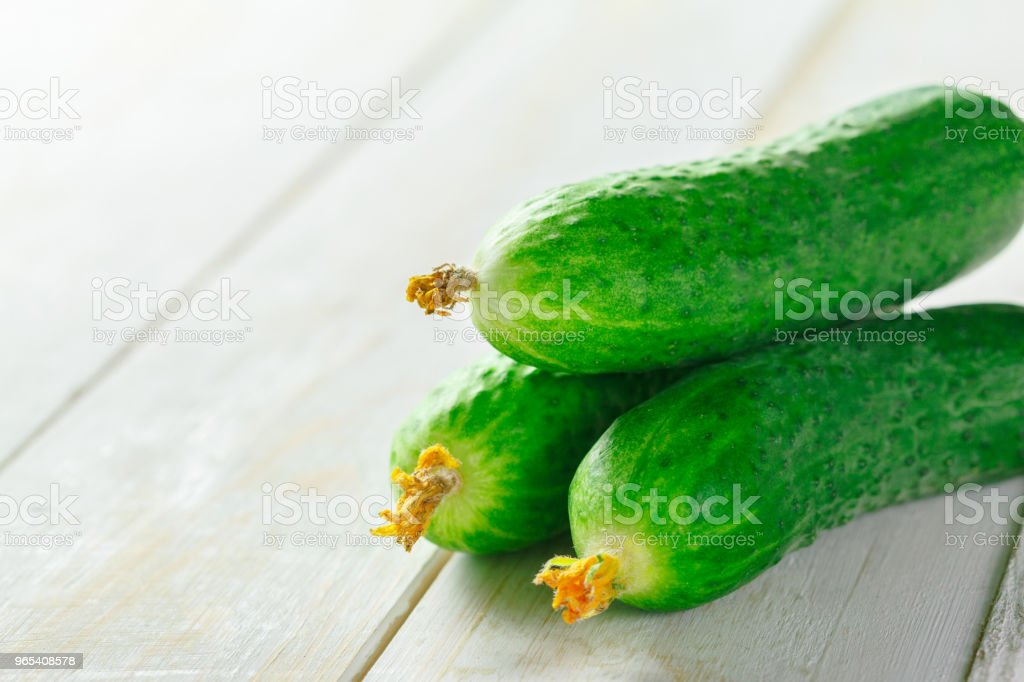 cucumbers on wooden background royalty-free stock photo