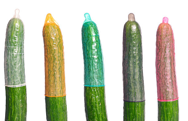 Cucumbers with condoms stock photo