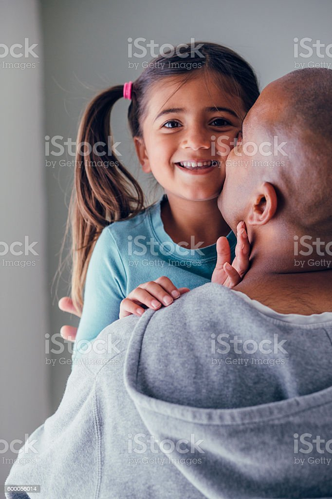 Cuddles with Dad stock photo