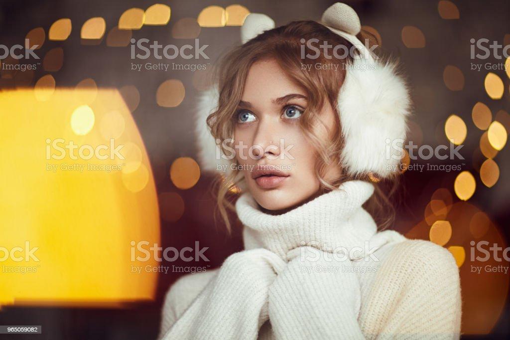 Cuddling blonde in winter earmuffs zbiór zdjęć royalty-free