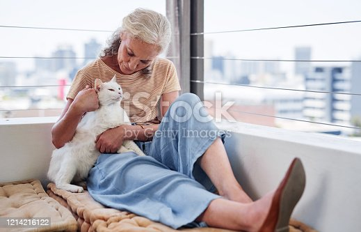 Cropped shot of an attractive senior woman cuddling with her cat while relaxing on the balcony at home