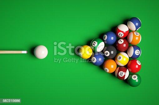 istock Cue aim billiard snooker pyramid on green table. 582315686