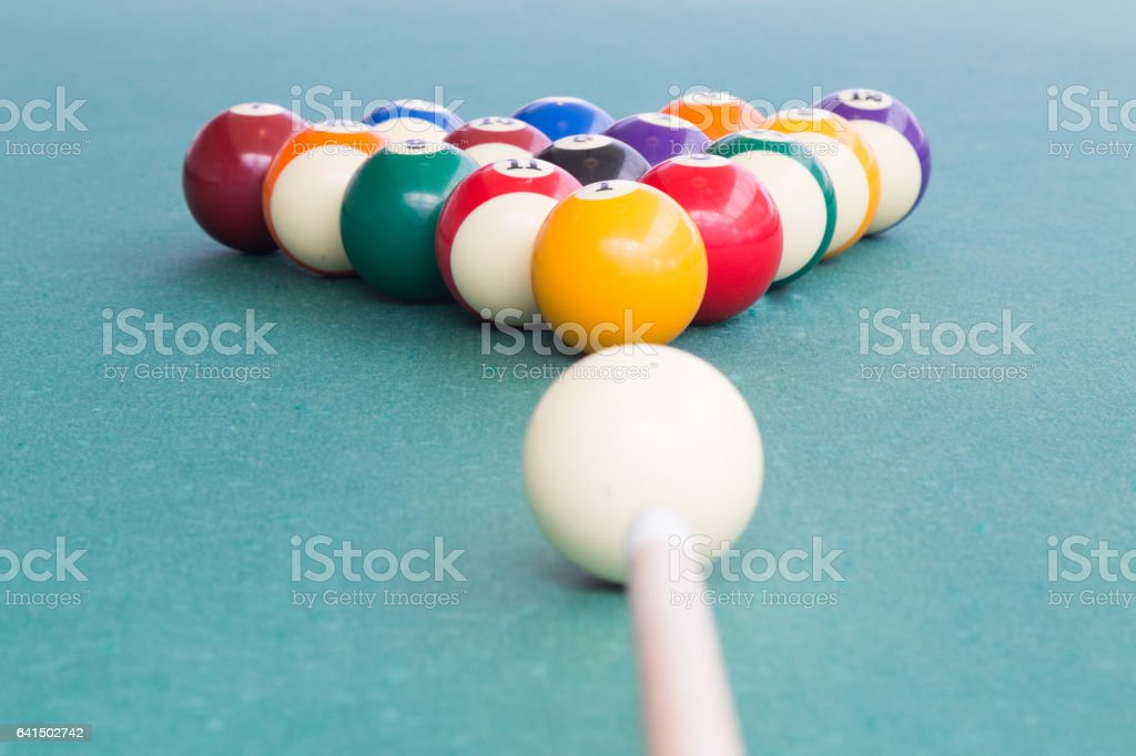 Cue aiming white ball to break snooker billards on table stock photo