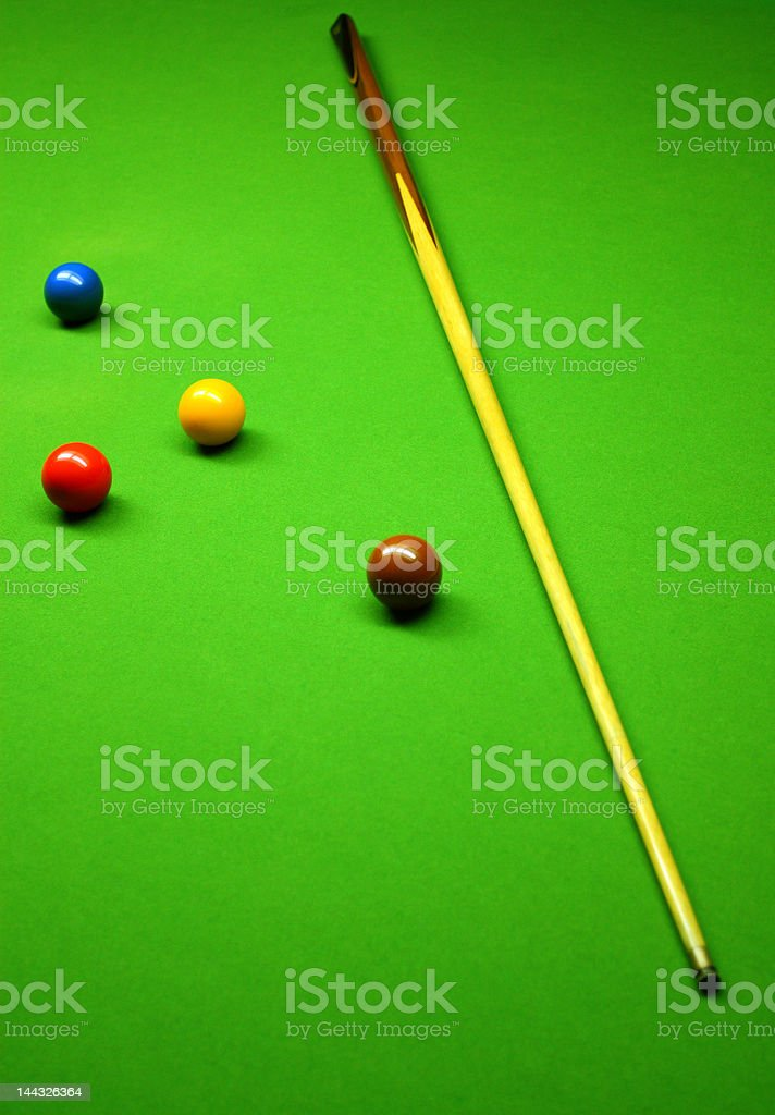 Cue stick and snooker balls over green surface royalty-free stock photo