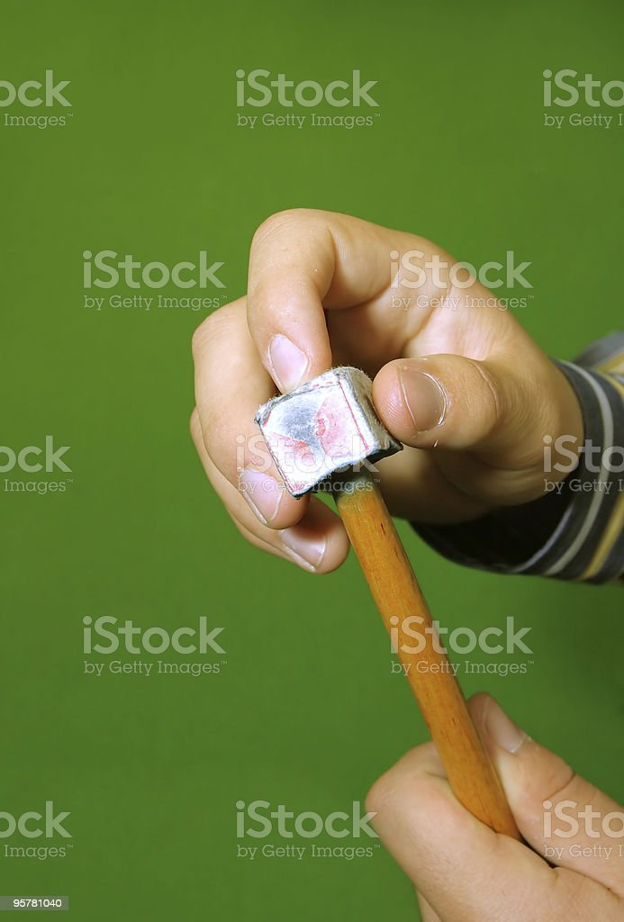 cue stick wit chalk block on green pool table royalty-free stock photo