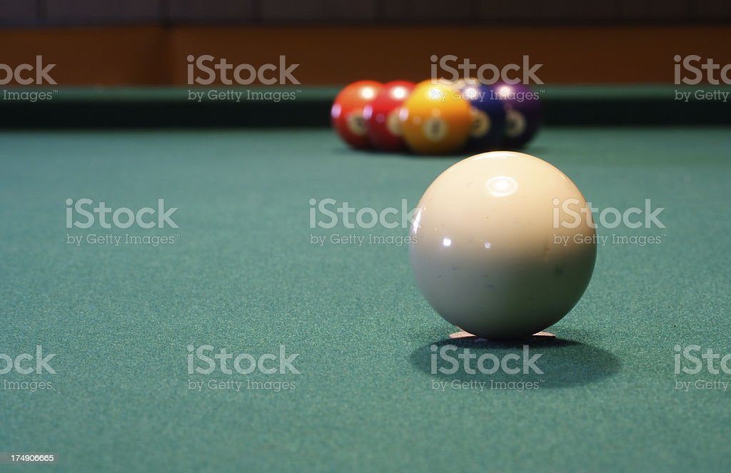 Cue with Rack of 9 Ball in the background royalty-free stock photo