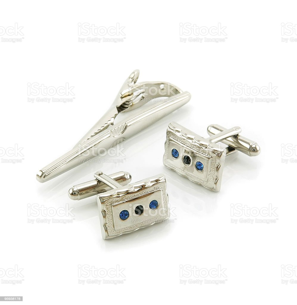 Cuff links and a tie-pin isolated stock photo