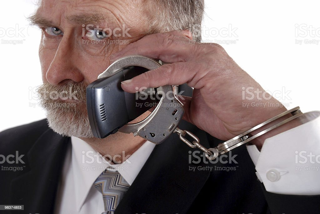 Cuffed to phone royalty-free stock photo