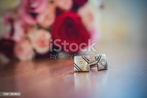istock Cufflinks for sleeves next to the wedding bouquet 1091280802
