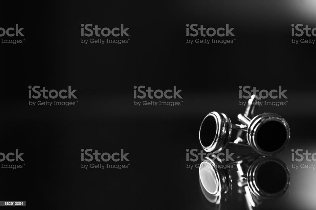 Cufflinks on black background royalty-free stock photo