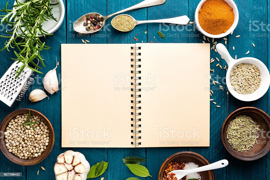 culinary background with spices and recipe book stock photo
