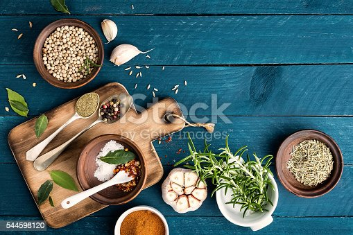 istock culinary background with spices on wooden table 544598120