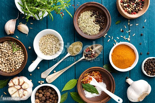 istock culinary background with spices on wooden table 544598354