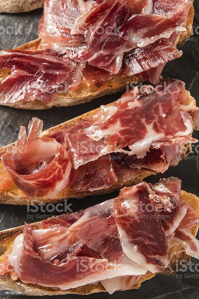 Culinary photograph of cured Serrano ham canapes stock photo