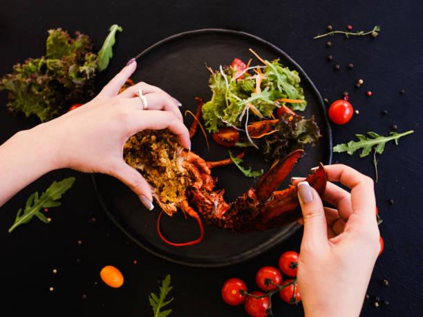 kulinarischen rezept gefüllte hummer gericht - kochkunst stock-fotos und bilder