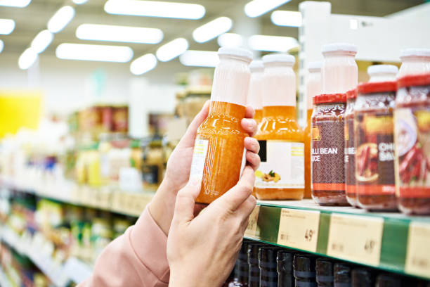 Culinary sauce in hand buyer at store stock photo