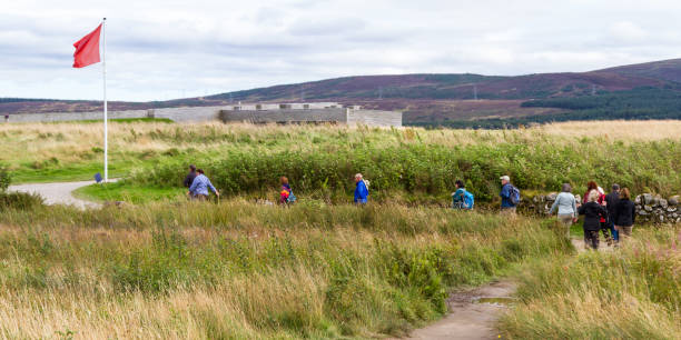 Culloden Battlefield Scotland  - September 08 2019: Tourists walking on the path experiencing the Culloden Battlefield, Scotland, UK September 08,  2019 culloden stock pictures, royalty-free photos & images